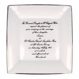 large square dish with wedding invite