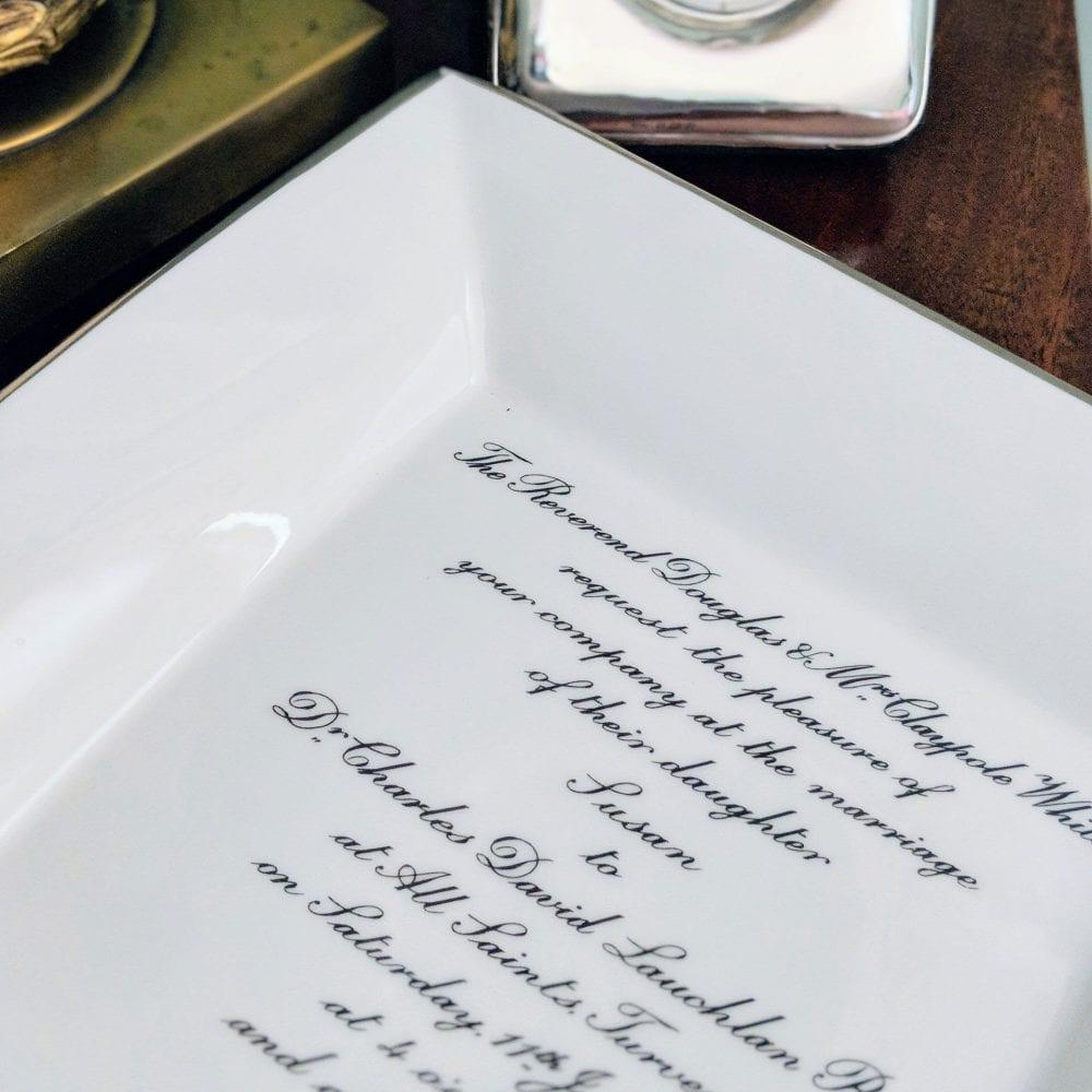 lifestyle shot of large square dish with wedding invitation