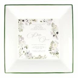 large square dish with wedding invitation