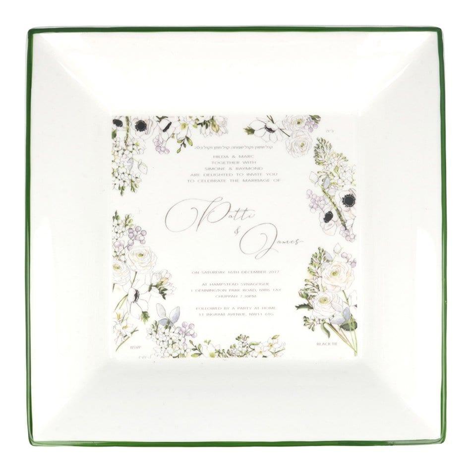 large square dish with wedding invitation