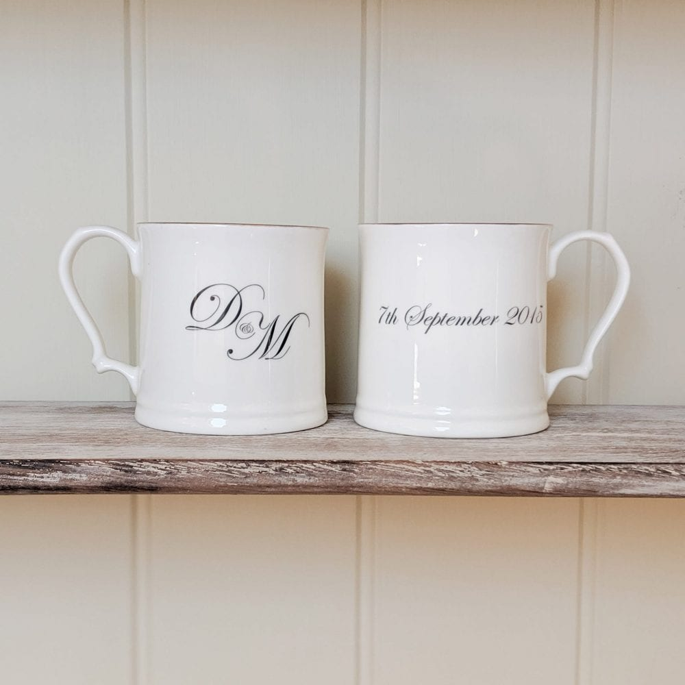 lifestyle shot of wedding mugs with initials and wedding date