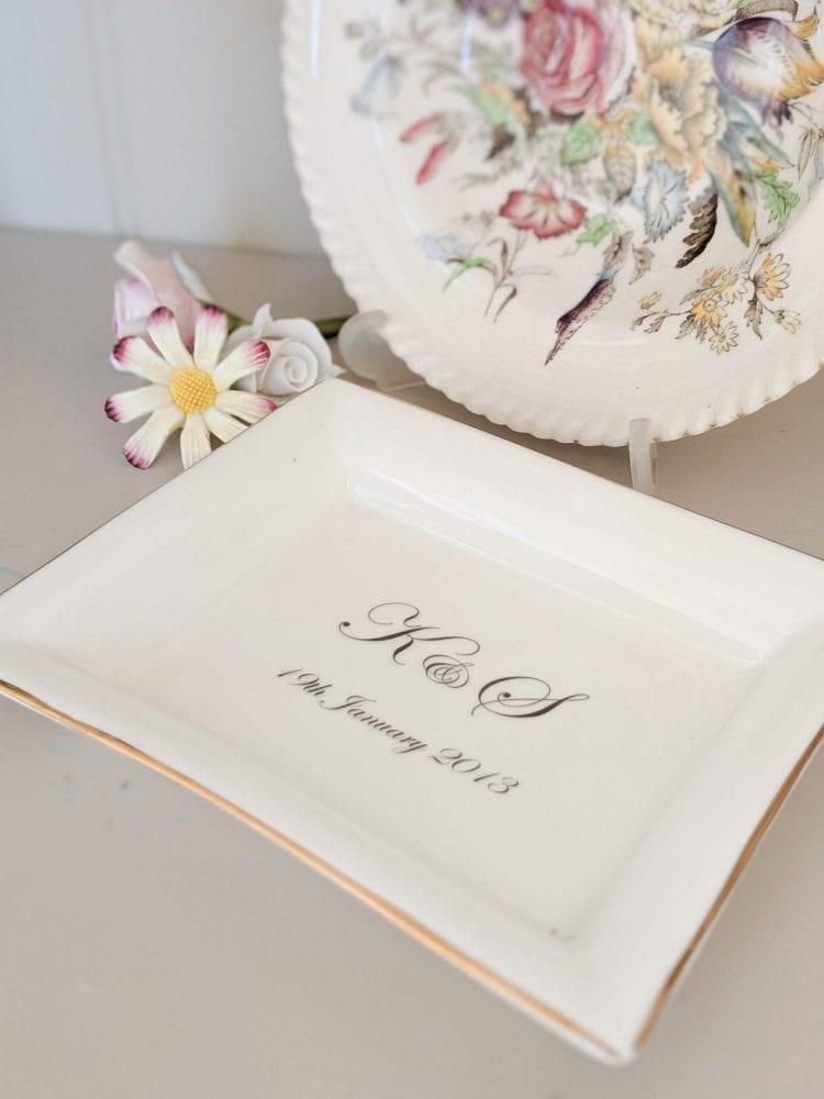 Mood shot of rectangular English bone china dish with initials and wedding date in Edwardian font