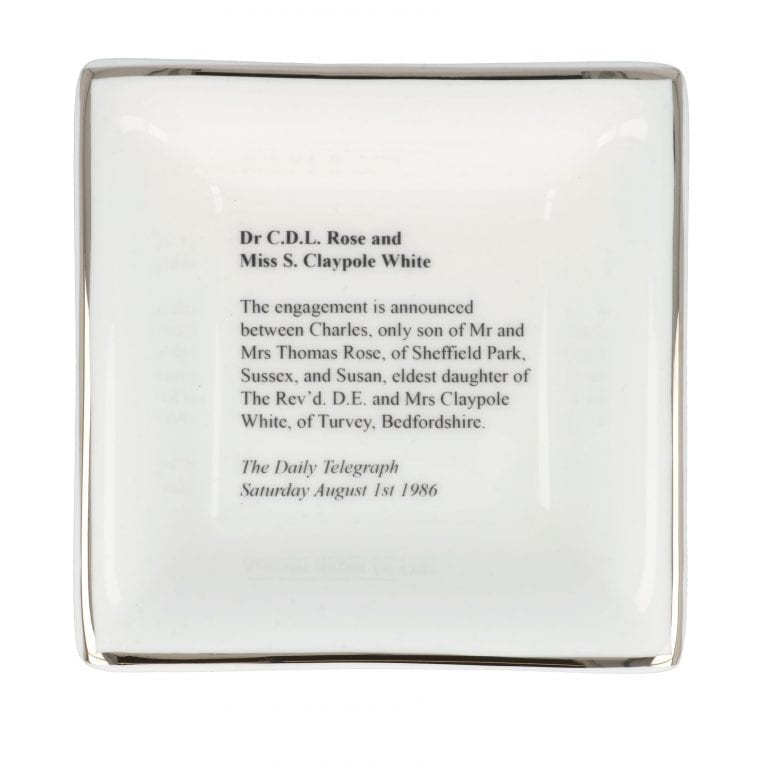 Engagement announcement on a small square dish