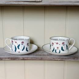 Racing silks teacups set shown an a shelf