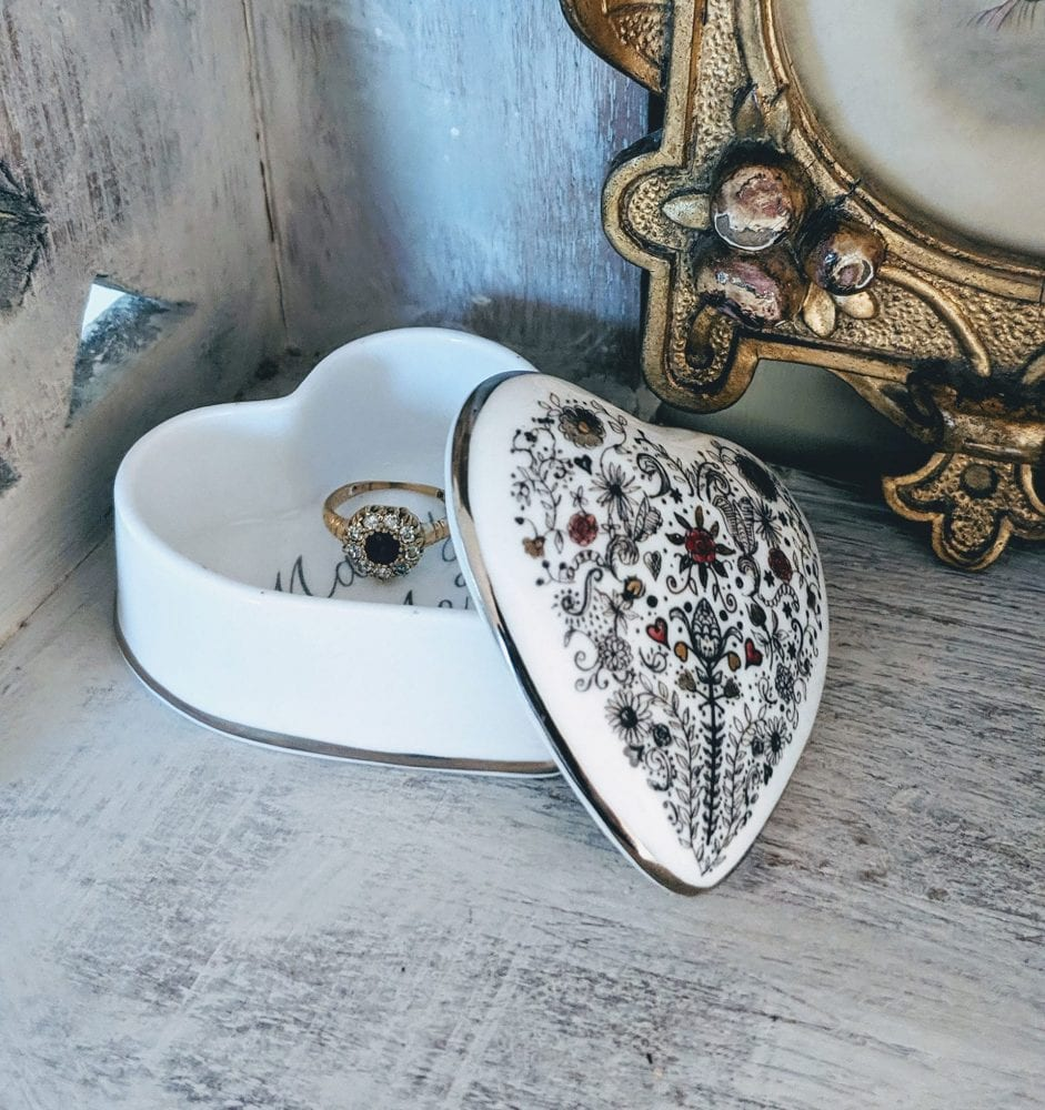 Heart shaped trinket with wedding ring inside