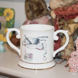 two handled loving cup with stork design