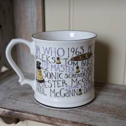 Doctor Who Mug full of History on shelf handle left