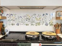 hand painted flowers on aga panel